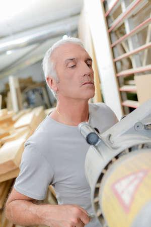 machinery machine: carpenter with machine Stock Photo