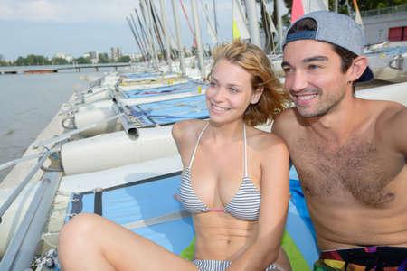 aboard: couple aboard a sailboat Stock Photo