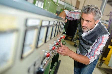 stabilize: technician fixing a complex machine