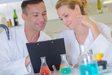 scientist reading a report Stock Photo