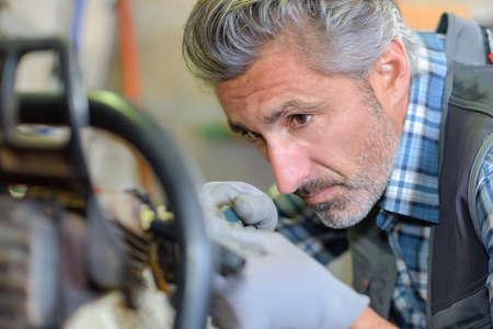 laborer: laborer fixing an equipment Stock Photo