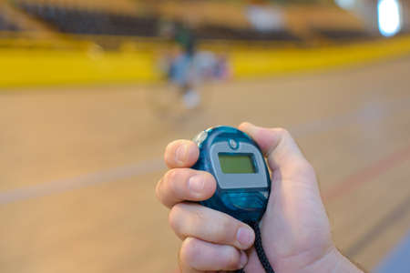 timescale: Closeup of hand on stopwatch