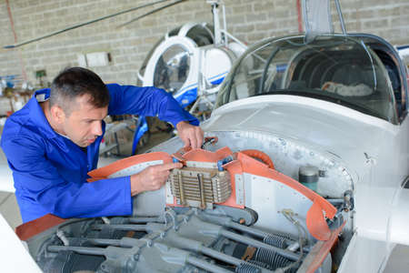 Mechanic working on aircraft