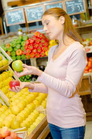 choose person: woman choosing apples