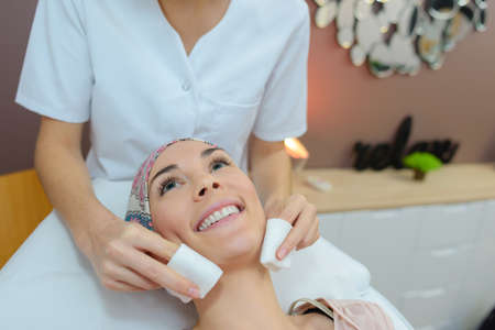 grooming product: client having a facial massage Stock Photo