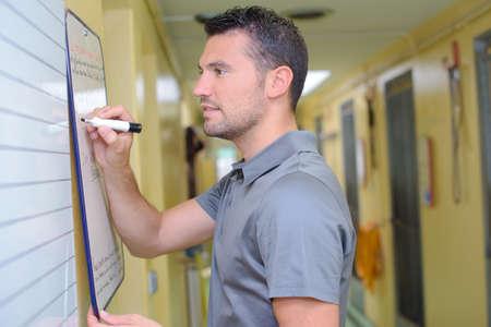 caretaker: caretaker writing on a whiteboard