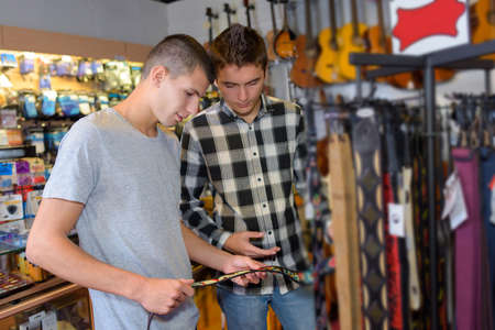 buying: friends buying guitar straps