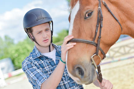 Young man with horse Stock Photo
