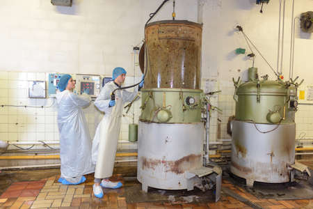 vats: Factory operatives working with large vats