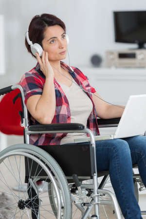 elected: disabled woman listening to music with headphones