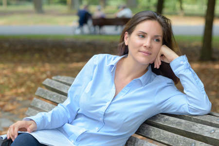 woman alone: Lady sat on park bench