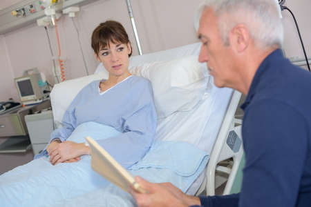 hospital patient: man reading to patient in hospital
