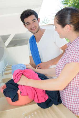 handwashing: Couple handwashing clothes