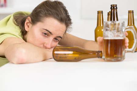 drunk woman slumped on table