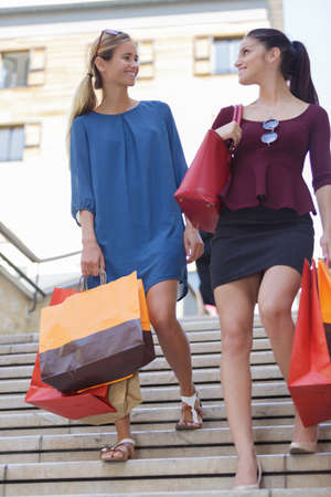 explores: young happy and wealthy women shopping