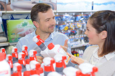 Salesman advising customer in hardware store Stock Photo