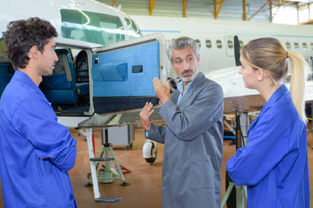 avionics: avionics apprentices in the hangar Stock Photo