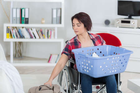 severely: loneliness and handicap are not issues when you love life Stock Photo