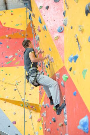 Man climbing indoor wall