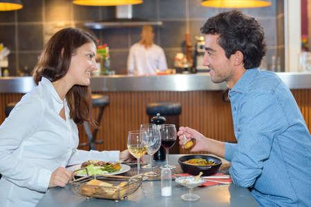 having lunch: couple having lunch in restaurant