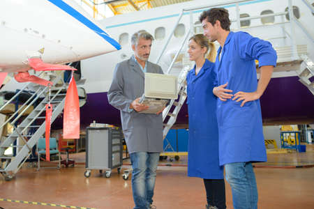 dismantle: aircraft system assemblers Stock Photo