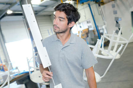 Man inspecting suspended object