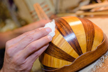 Hand polishing musical instrument