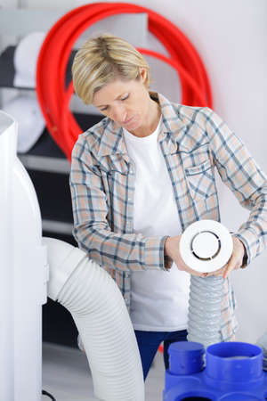 female artisan installing wiring system