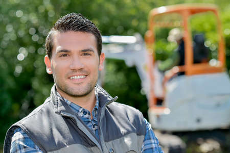 foreman: Foreman overseeing garden renovation Stock Photo