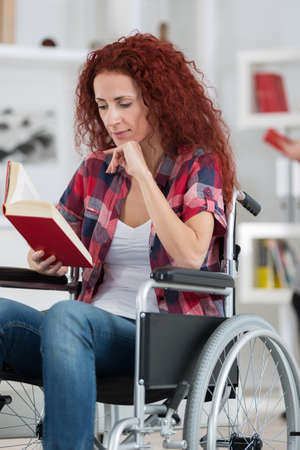 collisions: young handicaped woman reading