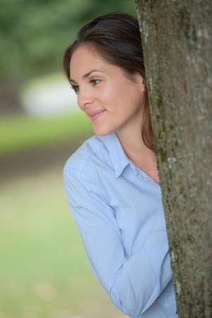 woman behind: woman behind a tree