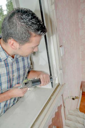 looker: window repairs Stock Photo