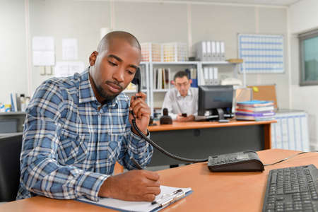jot: Taking notes during a phone call Stock Photo