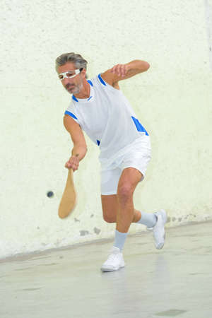 Active sportsman with racket
