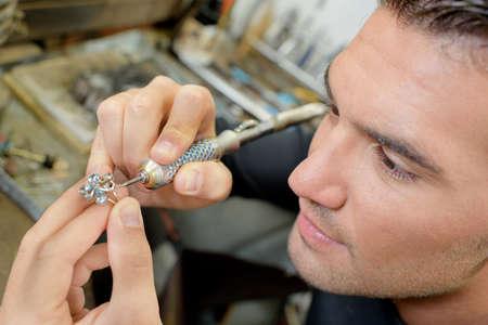 Jeweller hard at work Stock Photo