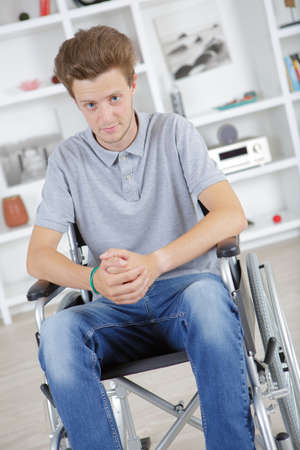 Portrait of young man in wheelchair