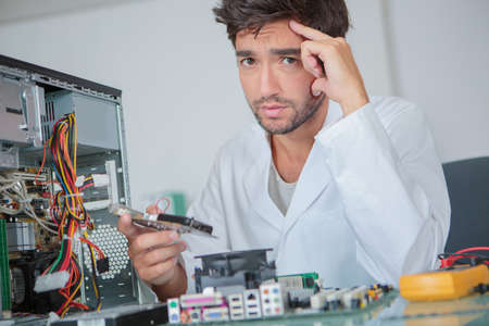 anguished: Anguished man with dismantled computer