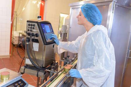 computerised: Factory operative setting up machine