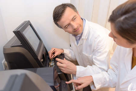 colorswatch: opticians working in the laboratory Stock Photo