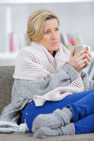 linctus: portrait of sick mature woman being treated for cold