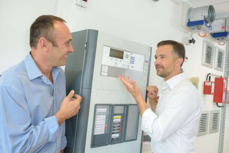 communication industry: Men looking at electrical equipment