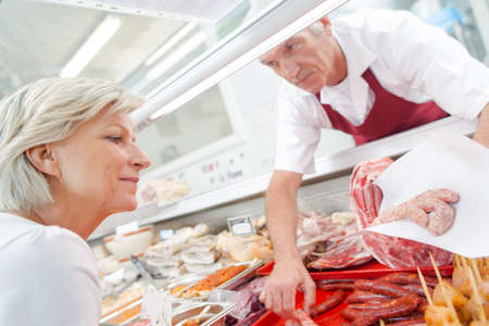 butcher with customer Stock Photo