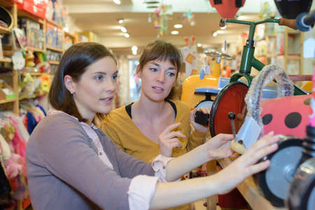 merchandiser: attractive customer and seller at the toy store