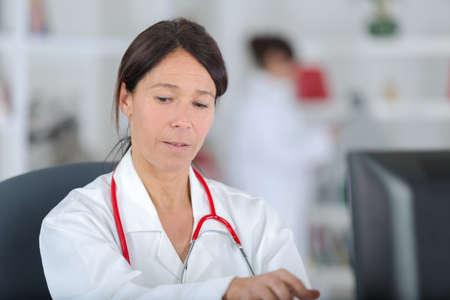 portrait of a beautiful female doctor working in her office