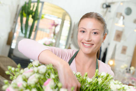 make a gift: Florist arranging some flowers