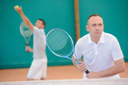 serf: doubles tennis match