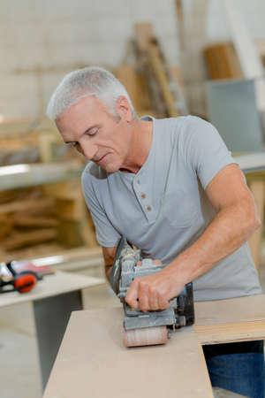 sander: Using a belt sander