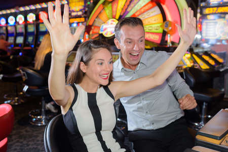 victorious: Victorious couple in casino Stock Photo