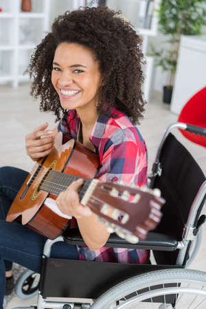 Disabled lady playing guitar