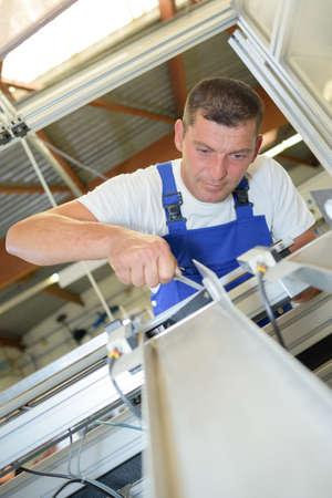 metal sheet: maintenance sheet metal worker Stock Photo
